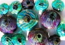 Make your own beautiful beads by melting glass in a hot flame!